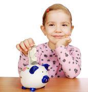 Little girl with piggy bank.JPG Stock Photos