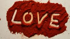 Young Adult Woman Writes LOVE in Red Chili Powder Stock Footage