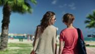 Stock Video Footage of Young girlfriends walking and talking to the beach, steadicam shot HD