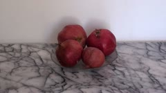 Pomegranates indoors zoom in Stock Footage