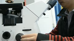 Scientist using microscope Stock Footage