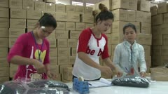 Textile Garment Factory: Great Multi-purpose shot of workers pack garments Stock Footage