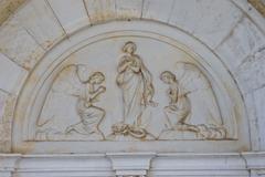 Bass relief on the Novigrad church - stock photo