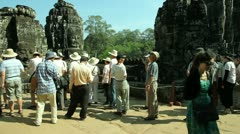 Tourists are visiting Bayon Temple in Angkor, Siem Reap in Cambodia Stock Footage
