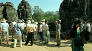 Stock Video Footage of Tourists are visiting Bayon Temple in Angkor, Siem Reap in Cambodia