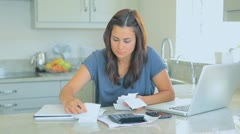 Agitated woman accounting her bills - stock footage