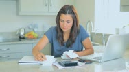 Stock Video Footage of Agitated woman accounting her bills