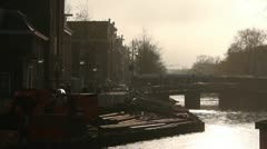 Amsterdam - Street and canal, typical Dutch metro is passing. Stock Footage