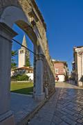 Stone arch and Euphrasian basilica tower in Porec Stock Photos