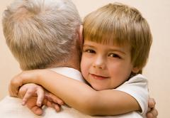 Little boy embrace his grandpa - stock photo