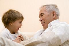 Adult senior with his grandchild Stock Photos