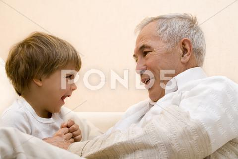 Stock photo of Adult senior with his grandchild