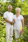 Mature loving couple in the garden - stock photo