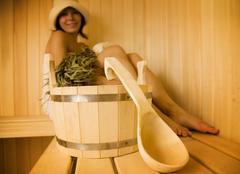 Young woman take a steam bath 1 - stock photo