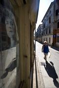Man walking on the Merchant`s street in Vodnjan - stock photo