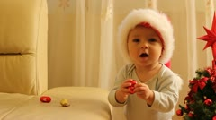 Stock Video Footage of Cute baby with Santa cap dancing