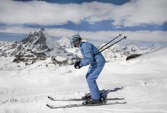 Young woman ski down - stock photo