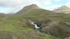 Iceland waterfall en route to Mjoifjordur fjord Stock Footage