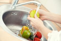washing vegetables - stock photo