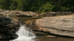 Natural Mountain River Flowing Down Over Stone and Rock - stock footage