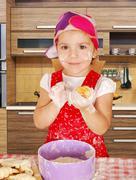 Little girl make rolls in kitchen.jpg Stock Photos
