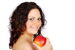 Happy beauty girl with apple.JPG Stock Photos