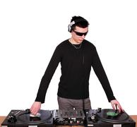 dj with sunglases play music.JPG - stock photo