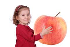 little girl holding big apple.jpg - stock photo