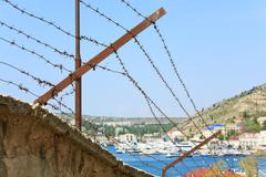 Seafront with ships at pier (balaclava town, crimea, ukraine) Stock Photos