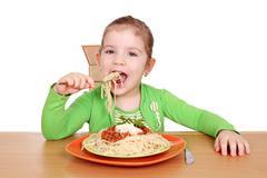 hungry little girl eating spaghetti.JPG - stock photo