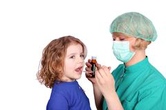 female doctor gives a little girl a cure.JPG - stock photo