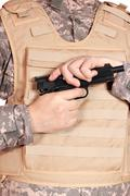 Soldier with pistol.JPG Stock Photos