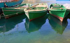 wooden boats at pier - stock photo