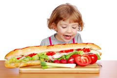 Hungry little girl.JPG Stock Photos