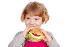 Little girl holding sandwich.JPG Stock Photos