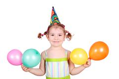 Little girl with birthday hat and balloons.JPG Stock Photos