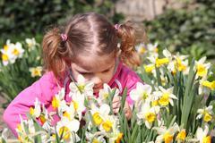 little girl smell flower.JPG - stock photo