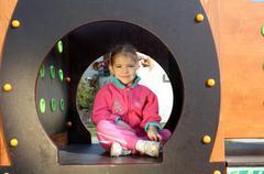 Little girl in playground.JPG Stock Photos