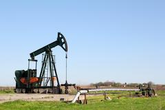 oil field with pump jack.JPG - stock photo
