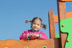 little girl posing in playground.JPG - stock photo