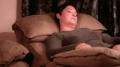 Woman asleep in a recliner Stock Footage