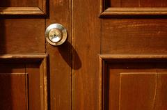 old wood door with handle on it - stock photo