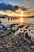 sunset rocky beach - stock photo