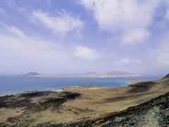 Famara cliffs and graciosa island, lanzarote, canary islands, spain Stock Photos