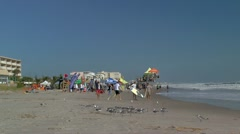 Surfers and surfboards along Cocoa beach Stock Footage