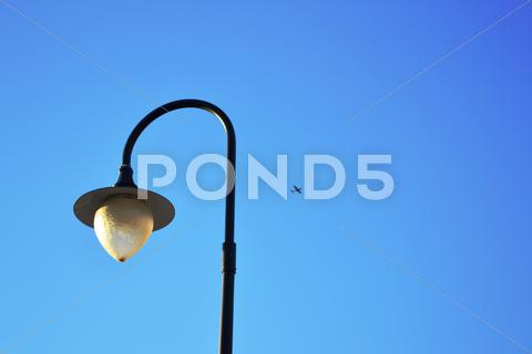 Stock photo of Street Lamp and Plane