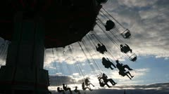 Swing ride under afternoon clouds Stock Footage