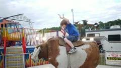 Boy Rides Mechanical Bull Stock Footage