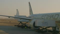 Loading Etihad plane in Abu Dhabi Stock Footage