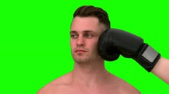 Video of man being hit his face on green background Stock Footage
